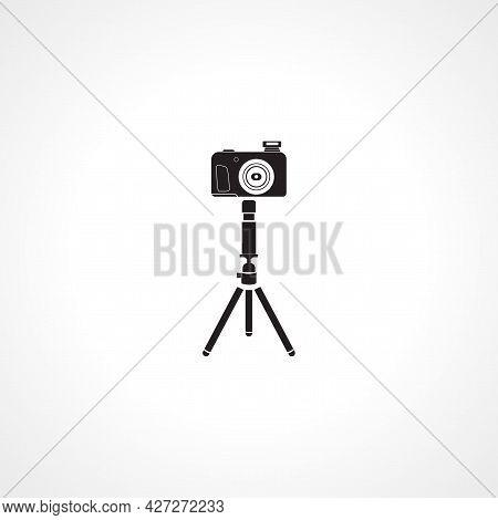 Camera On Tripod Icon. Camera On Tripod Isolated Simple Vector Icon.