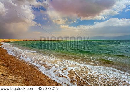 Israel. After a thunderstorm at the Dead Sea. The clouds are parting. Magnificent exotic resort for treatment and relaxation. The Dead Sea is a closed salt lake