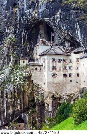 Old medieval castle in the park. Magical places in Slovenia. The famous and most visited place in the country by tourists.  Postojna Cave on Limestone plateau.