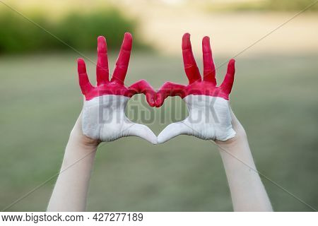 Kid Hands In Heart Form Painted In Flag Monaco Or Indonesia. Tourist Made Gesture By Indonesia Flag