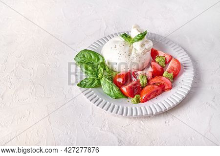 Traditional Italian Burrata Cheese With Basil And Tomato On Light Background. Close Up