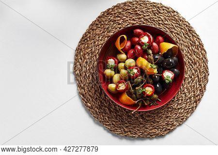 Pickled Vegetables In A Plate, Olives, Olives, Stuffed Peppers, Radishes. Assorted Vegetables, Veget