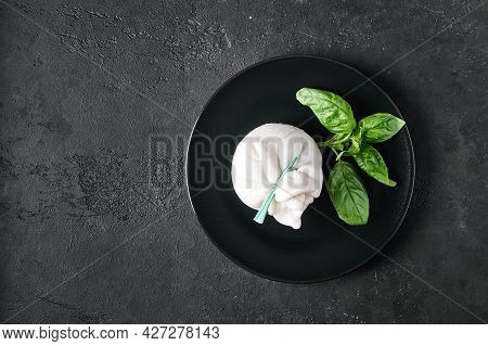 Traditional Italian Burrata Cheese With Basil On Dark Plate. Top View, Copy Space