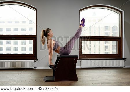 State-of-the-art Equipment Classic Reformer Chair For Pilates In The Gym, Concept Of Wellness And Re