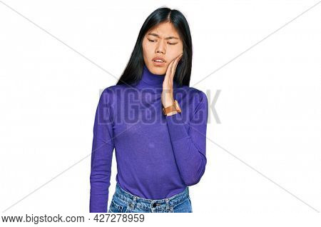 Beautiful young asian woman wearing casual clothes touching mouth with hand with painful expression because of toothache or dental illness on teeth. dentist