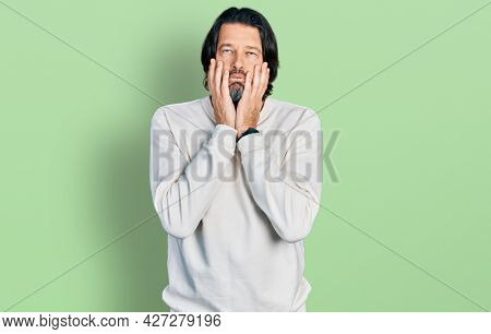 Middle age caucasian man wearing casual clothes tired hands covering face, depression and sadness, upset and irritated for problem