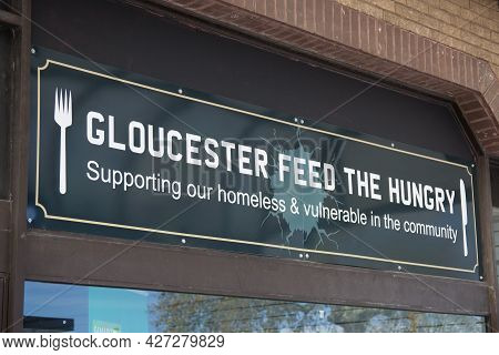 Gloucester Feed The Hungry Sign In Gloucester In The Uk, Taken On The 24th April 2021