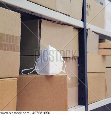 Medical Mask Respirator N95 Ffp2 In Stock Among Cardboard Boxes
