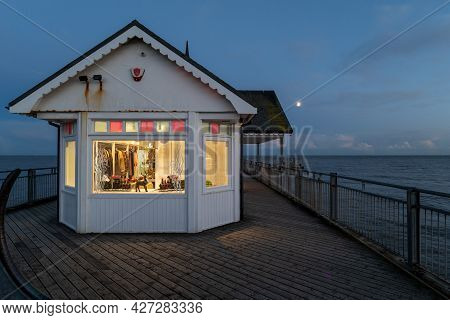 A View Of Southwold Pier At Sunset On A Cold Autumn Evening