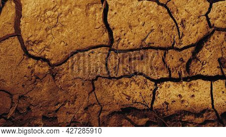 Brown Soil Background. Cracked Soil Texture. Brown Soil Background.