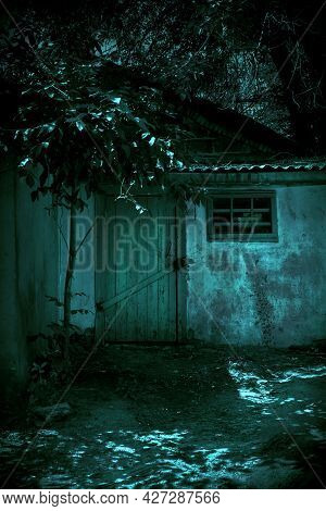 Scary Grunge Background In Horror Style, Closed Door To A Dangerous Barn Of An Old Crumbling House I