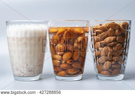 Glasses With Dry, Soaked Almonds And With Almonds Milk. Showing Ingredients Needed To Prepare Almond