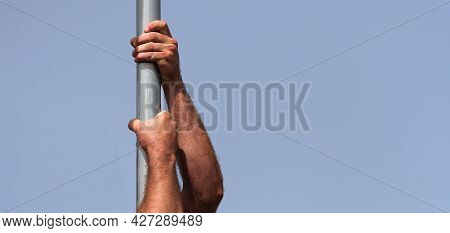 Athletic Man Working Out And Climbing A Pole, During Obstacle Course In Boot Camp