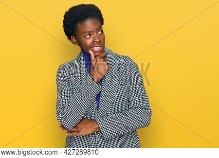 Young african american girl wearing casual clothes thinking worried about a question, concerned and nervous with hand on chin