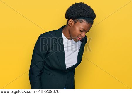 Young african american girl wearing business clothes suffering of backache, touching back with hand, muscular pain
