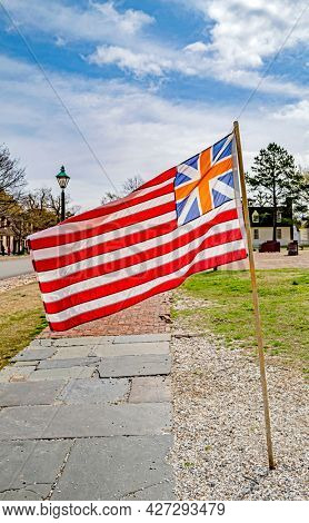 Old colonial Grand Union flag in Williamsburg, Virginia, USA