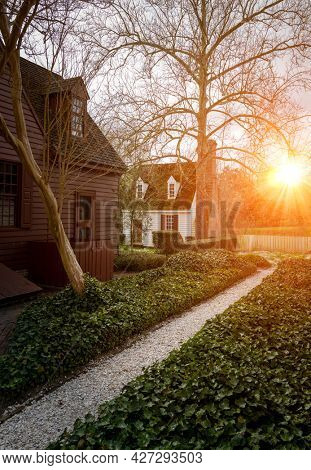 Sunset over a beautiful garden and cottages