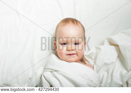 Baby On Bed Close-up. Baby Sleep , Childcare, Teething, Colic