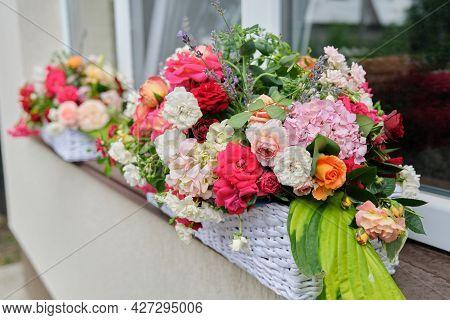 Flower Arrangement In A Basket. Flower Decoration Of Events, Floristry, Natural Beauty, Holidays