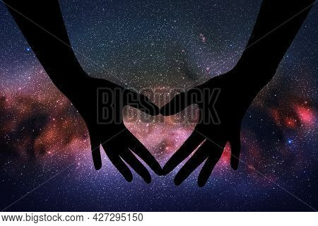 Heart Shaped Hands. Hand Gesture Silhouette. Starry Sky And Milky Way