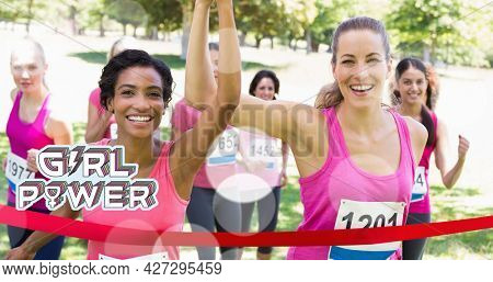Composition of girl power text over group of women smiling. girl power, positive female strength and independence concept digitally generated image.