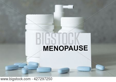 Menopause Text On A White Card Next To White Medicine Jars. Medical Concept.