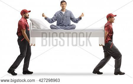 Movers carrying a bed with man in pajamas sitting and meditating isolated on white background