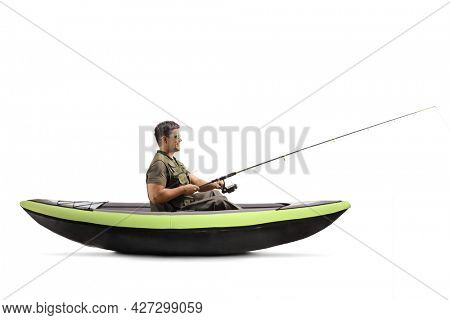 Young man catching fish and sitting in a kayak isolated on white background