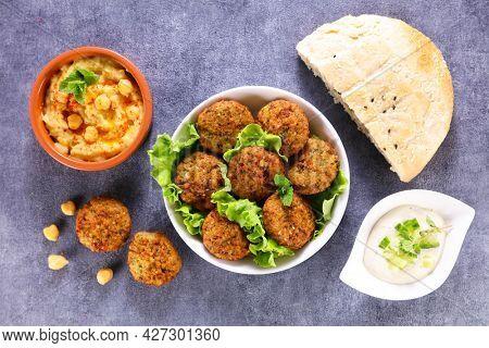 lebanese food selection- hummus,  pita bread and falafel