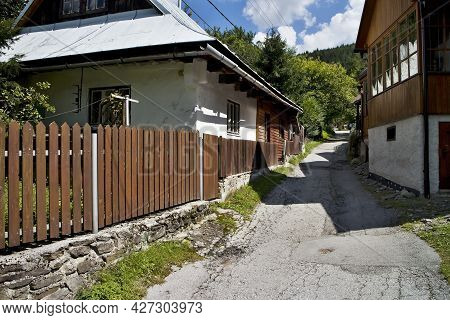 Spania Valley, Slovakia: A Typical Alley Between Older Houses In The Mining Village Spania Valley.