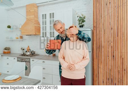 Husband Gives A Gift To Her Wife At Home