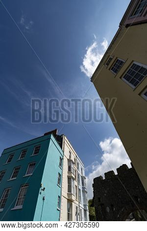 Looking Up At Tenby Buildings And Walled Fortifications