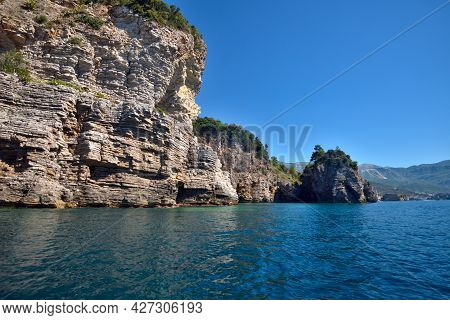 Picturesque View Of The Cliffs From The Sea. Budva Riviera, Montenegro