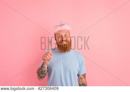 Happy Man With Beard And Tattoos Acts Like A Princess Of A Tale