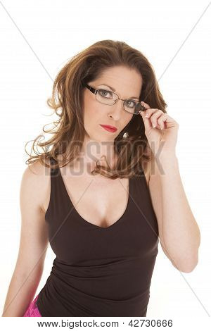 Woman Looking And Holding Edge Of Glasses