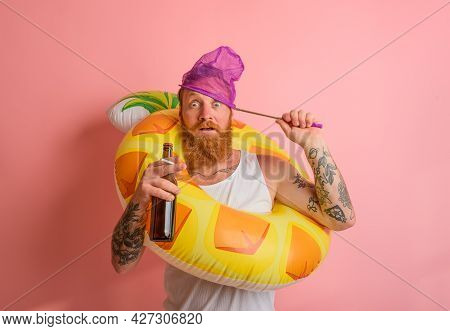Amazed Man Is Ready To Swim With A Donut Lifesaver With Beer And Cigarette In Hand