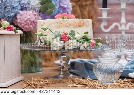 White Wedding Cake Decorated By Flowers Standing Of Festive Table. Copy, Empty Space For Text