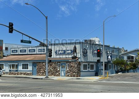SUNSET BEACH, CALIFORNIA - 16 JUL 2021: Captain Jacks on Pacific Coast Highway, a surf and turf restaurant famous for its crab legs.