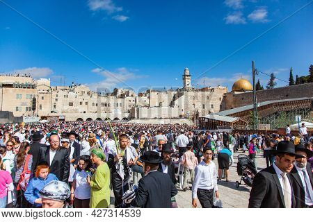 JERUSALEM, ISRAEL - NOVEMBER 16, 2011: Great religious Jewish holiday. Thousands of Jews pray at the Western Wall. The Old City of Jerusalem. The Wailing Wall is part of the ancient wall