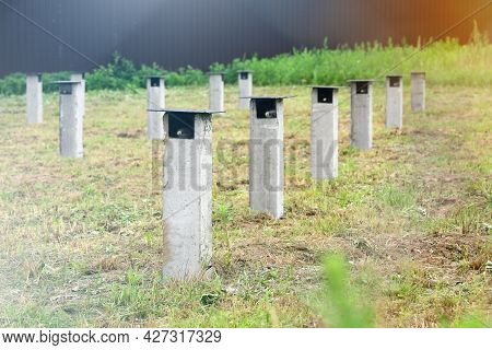 Selective Focus, Concrete Piles Pillars Of Construction Foundation For Future House