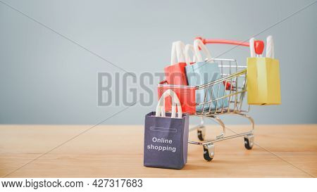 Small Dark Purple Shopping Paper Bag With Online Shopping Text Blurred Shopping Cart For  E-commerce