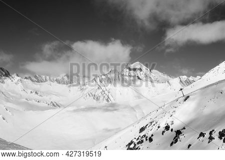 Black And White Off-piste Slope And Chair-lift On Ski Resort At Sun Day. Winter Caucasus Mountains I