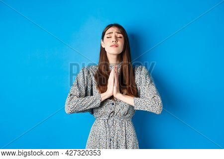 Pleading Woman In Dress Begging For Wish Come True, Supplicating God, Standing Against Blue Backgrou