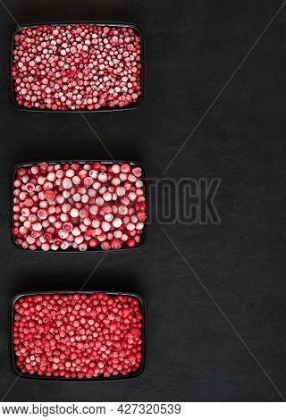 Frozen Berries Set On A Black Background. Berries In Containers. Preparations For Freezing. Cranberr