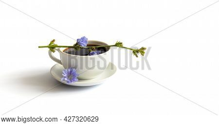 Chicory Drink. A Cup Of Chicory Coffee And Blue Flower On A White Background. Healthy Decaffeinated