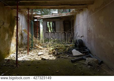 Collapsed Roof In Antigua, In Typical Rustic Farm, Abandoned, Broken And Old In Ruins, Propped Up Wi