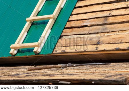 A Tool For Many Wooden Boards. Hammer And Nails - Construction Hammer Wood. Installing Metal Roofing