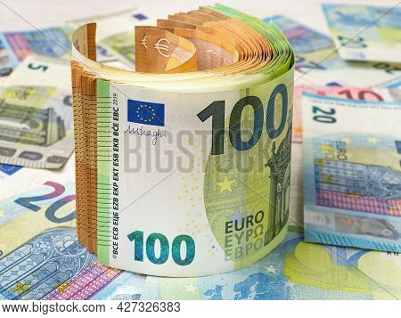 Roll Of 100 And 50 Euro Paper Banknotes Over Money Background. Concepts Of Cash Savings And Wealth,