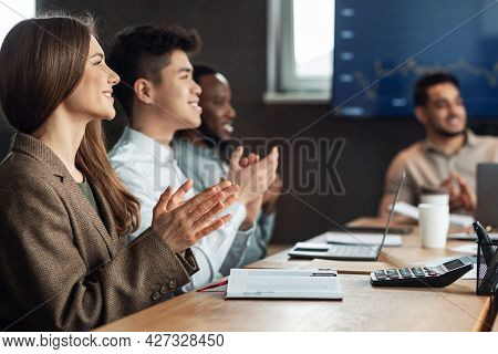 Smiling Happy Colleagues Having Training In Boardroom, Clapping Hands