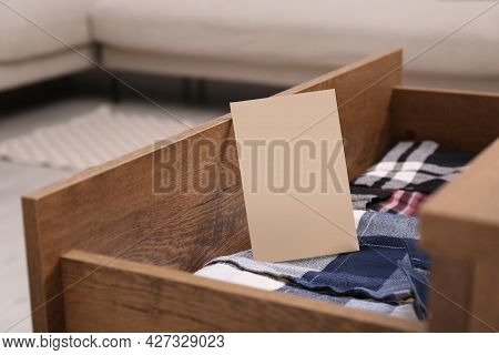 Scented Sachet And Folded Clothes In Drawer